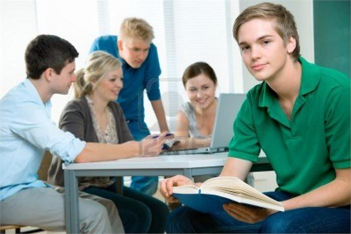 Image of students in classroom collaborating