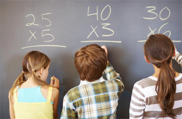 Image of students at blackboard working math problems